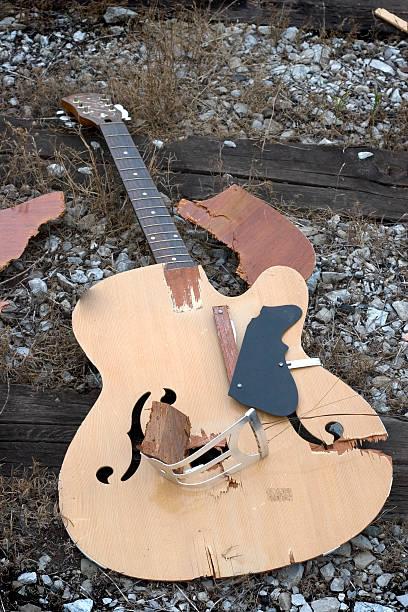 broken dreams - broken guitar stock photos and pictures