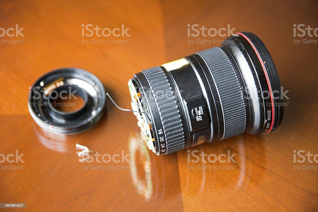 Broken dropped wide angle camera lens stock photo