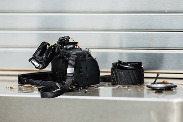 Broken DSLR camera stock photo