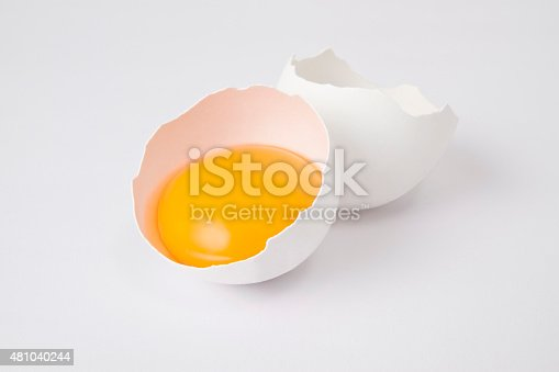 Cracked egg isolated on white background.