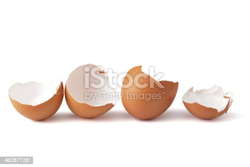 Broken egg shells in a row on white background