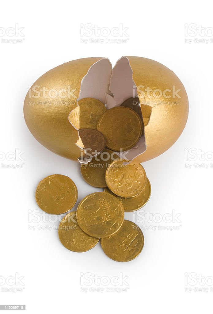 Broken egg with golden coins. royalty-free stock photo