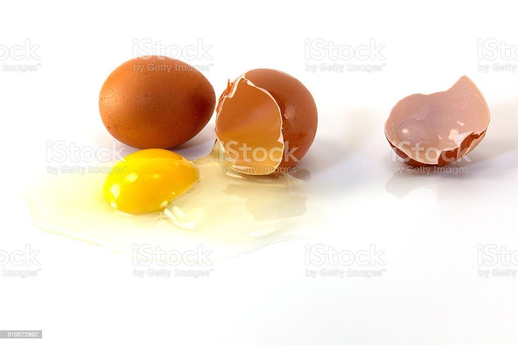 Broken egg with yolk stock photo