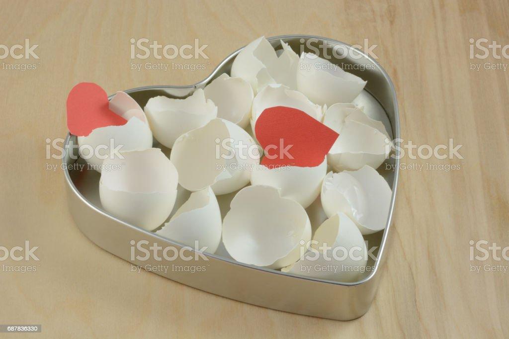 Broken Eggshells and hearts stock photo