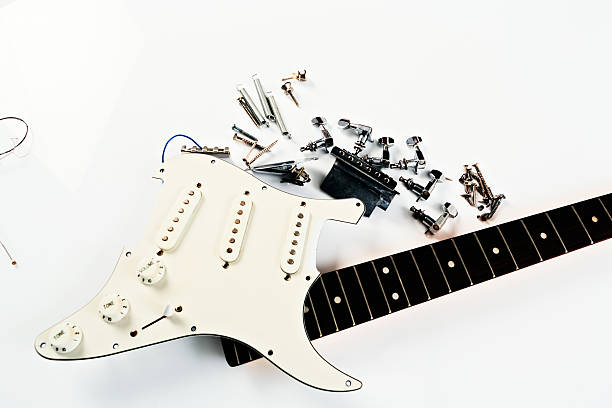 broken electric guitar waits to be fixed - broken guitar stock photos and pictures
