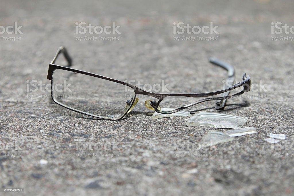 broken eyeglasses on concrete stock photo