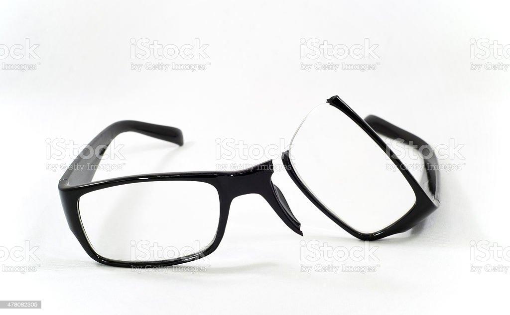Broken eyeglasses stock photo