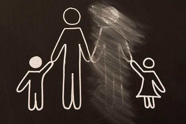 broken family on a blackboard stock photo