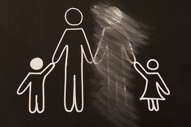 broken family on a blackboard stock photo