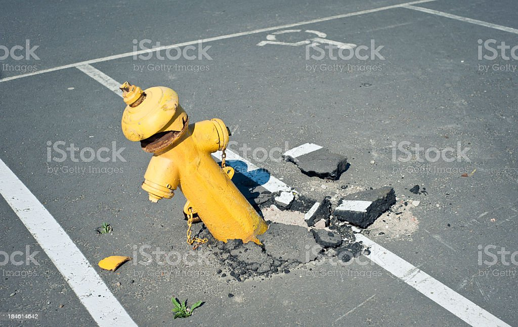 Broken Fire Hydrant In The Asphalt stock photo