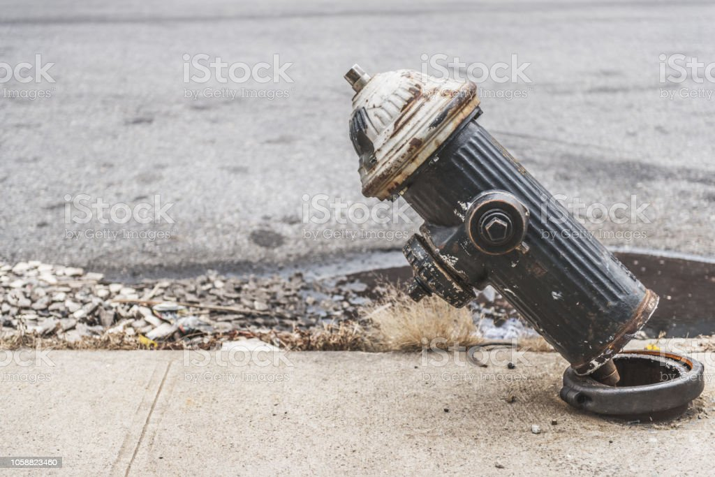 Broken fire hydrant sidewalk stock photo