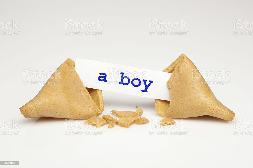 Broken fortune cookie with fortune stating it's a boy royalty-free stock photo