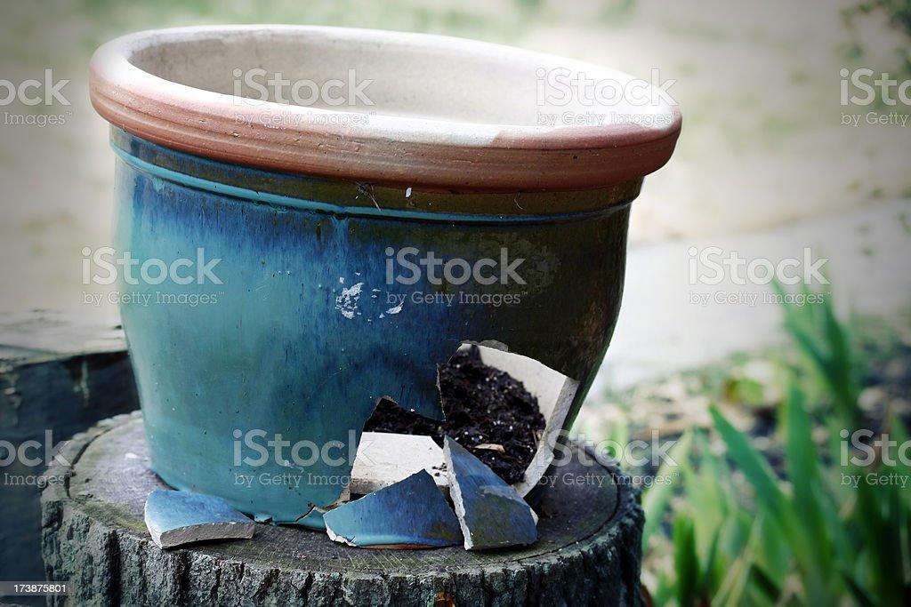 Broken garden pot on stump effect royalty-free stock photo