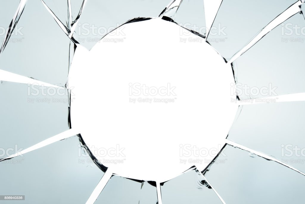 Broken glass and hole isolated on white texture wallpaper background...