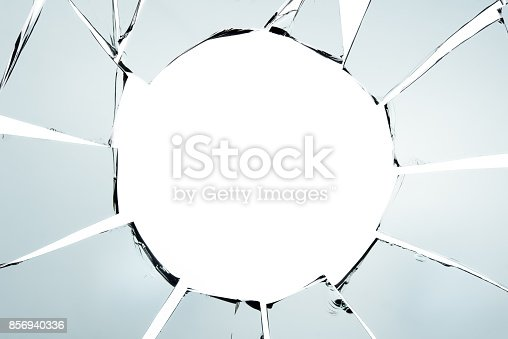 istock Broken glass and hole isolated on white texture wallpaper background  object design crash accident concept 856940336