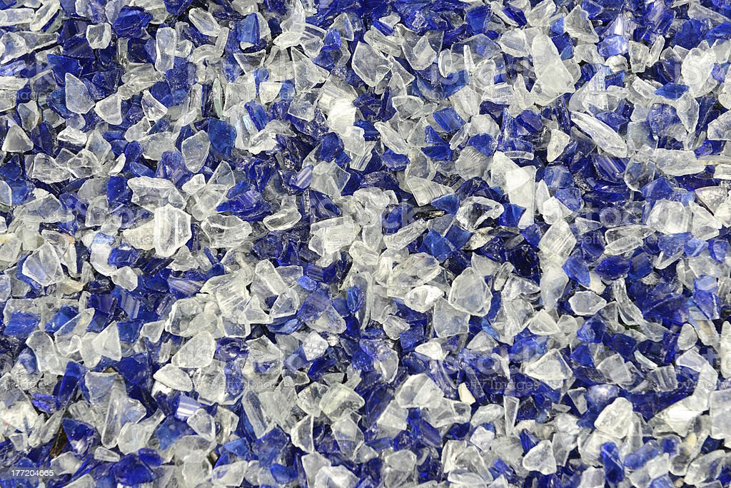 broken glass blue shards ready for recycling stock photo
