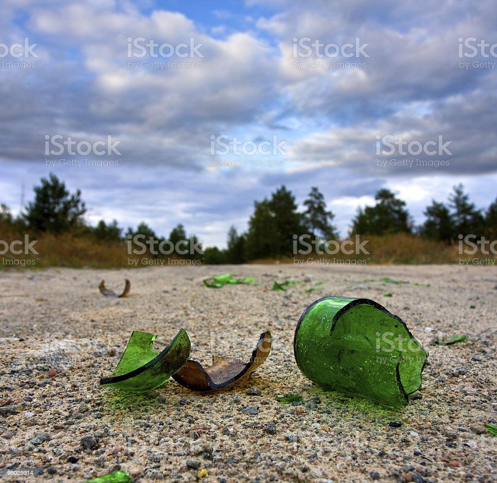 broken glass bottle on road royalty-free stock photo