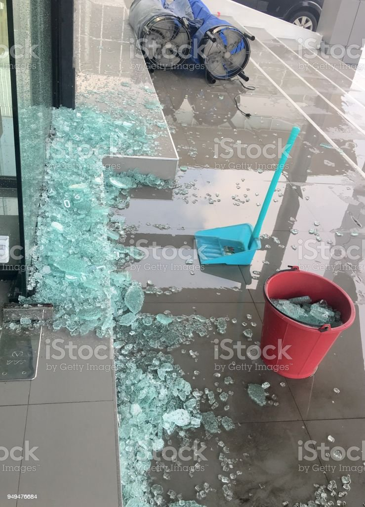 Broken glass door on the floor after storm come and waiting for cleaning stock photo