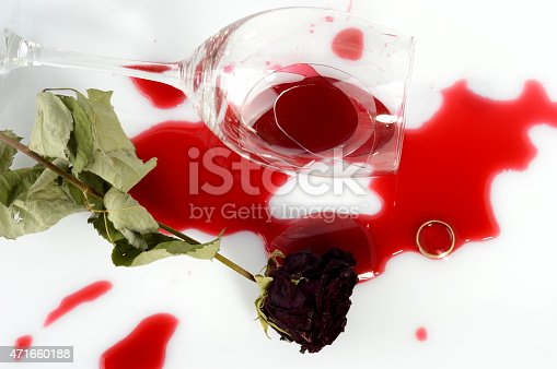 istock Broken glass, faded rose and a ring after an argument 471660188