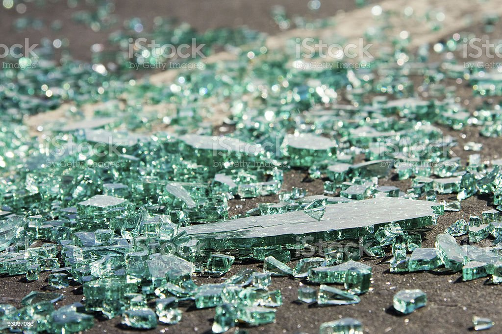 Broken Glass in a Parking Lot royalty-free stock photo