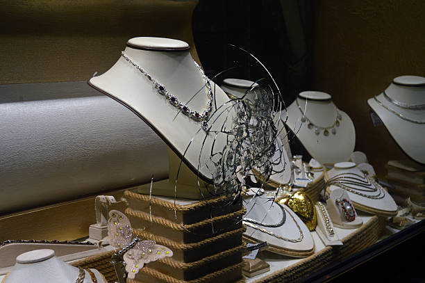broken glass jewelry store gold, brilliant, outdoors - thieves breaking jewelry store glass stock photos and pictures