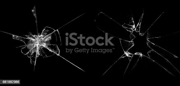 istock Broken glass on a black background 681882986