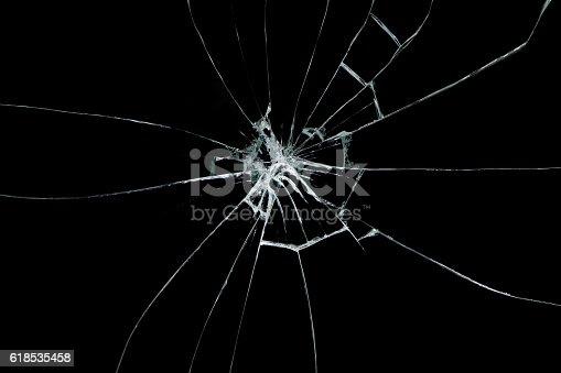 istock Broken glass on black background 618535458