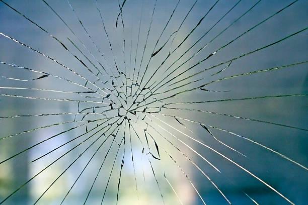 Broken glass on the window stock photo