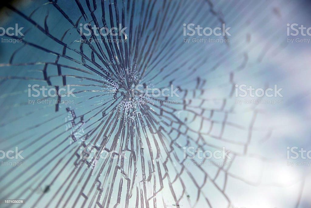 Broken glass reflecting sky royalty-free stock photo