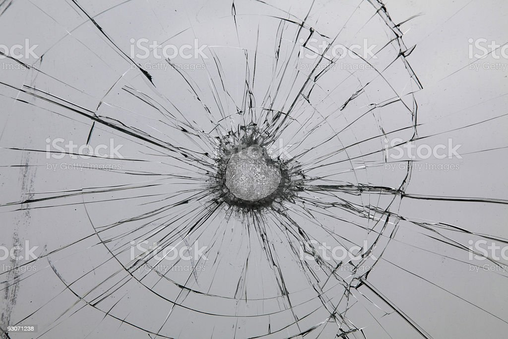 A broken glass shatters into a thousand pieces royalty-free stock photo