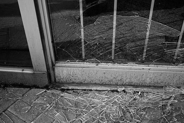 Broken glass storefront stock photo