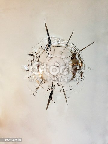 Broken glass triple bullet hole in glass isolated on white