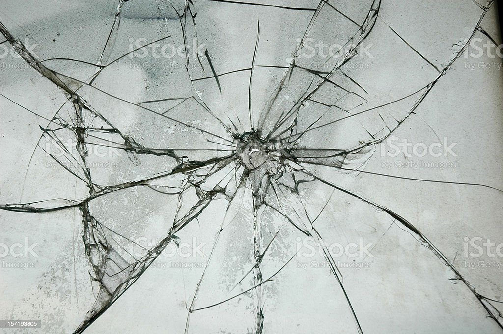 Broken Glass Window Bullet Shooting impact hole cracks royalty-free stock photo