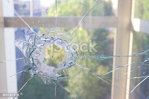 istock broken glass window reflecting blue sky 920787318