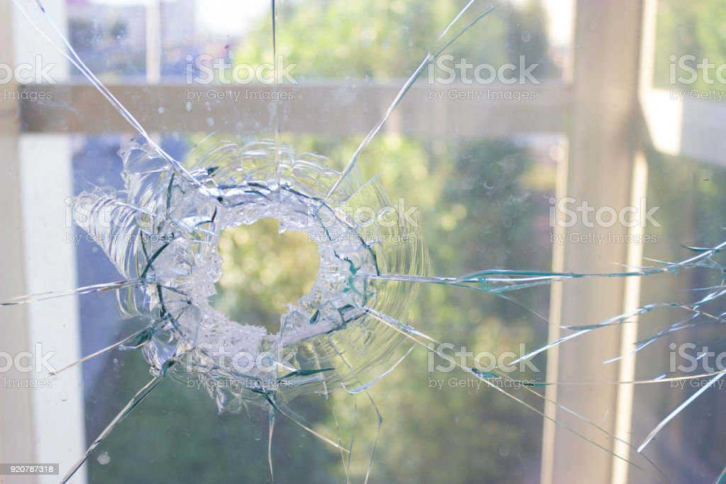 broken glass window reflecting blue sky stock photo