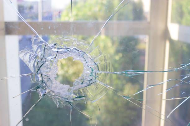 broken glass window reflecting blue sky stock photo