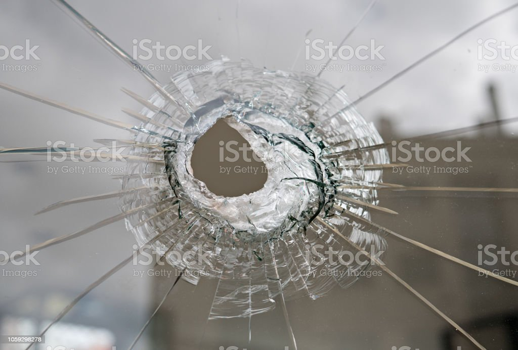 Broken glass with hole stock photo