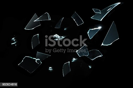 istock broken glass with sharp Pieces over black 932624816