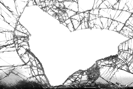 Broken glass with the shape of a heart fallen out