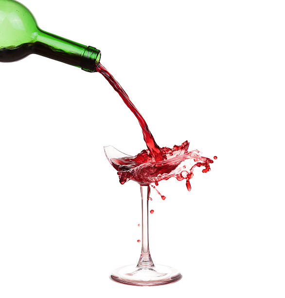 Broken glass with wine and drops ,isolated on white background stock photo