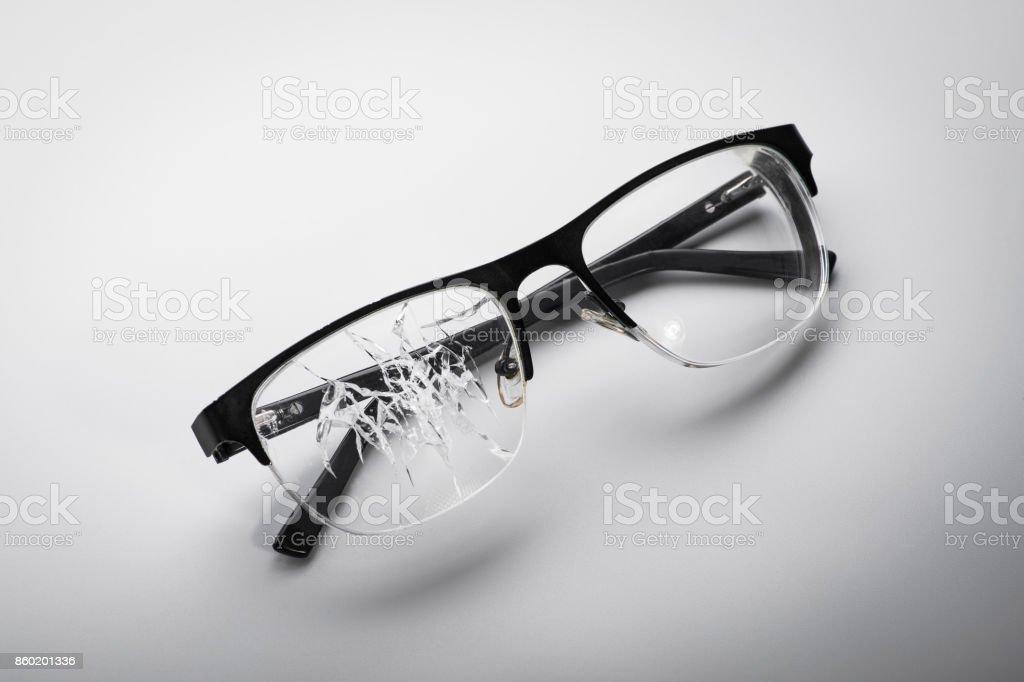 broken glasses on a white background stock photo