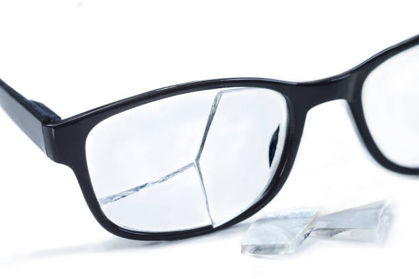 broken glasses on awhite background. concept of failure stock photo