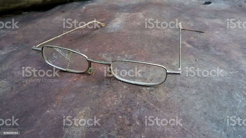 Broken glasses on scratched rusty metal surface stock photo