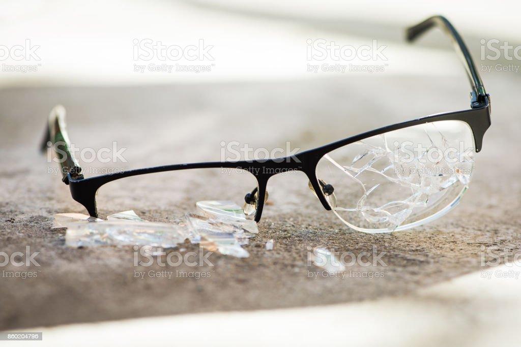 broken glasses on the asphalt stock photo