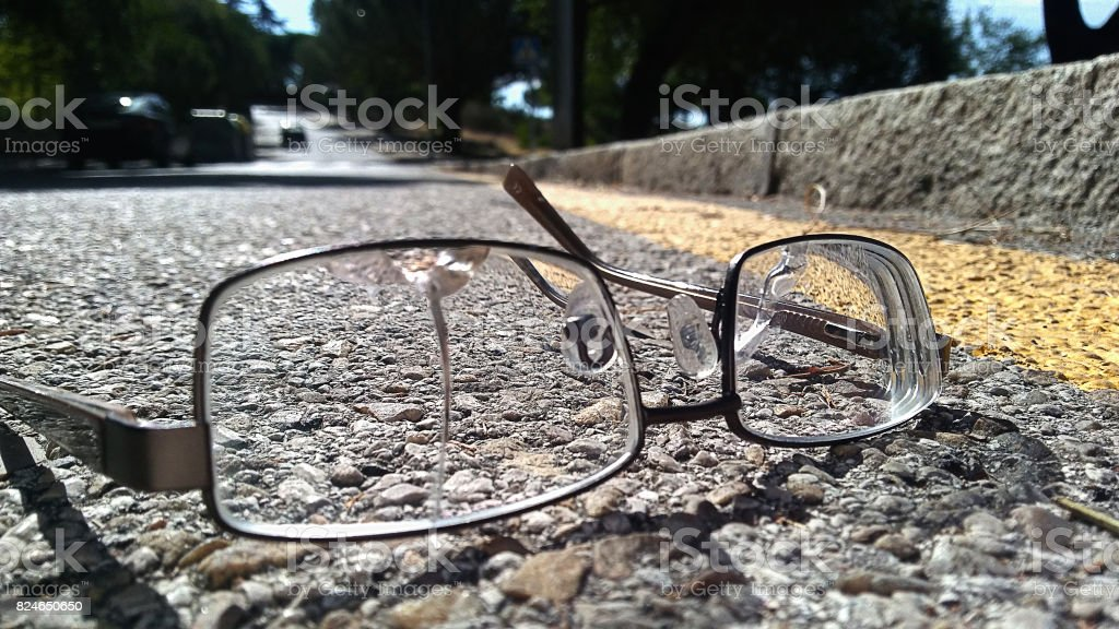 Broken glasses on the road stock photo