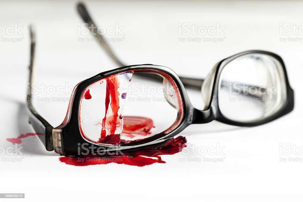 Broken glasses with blood on it stock photo