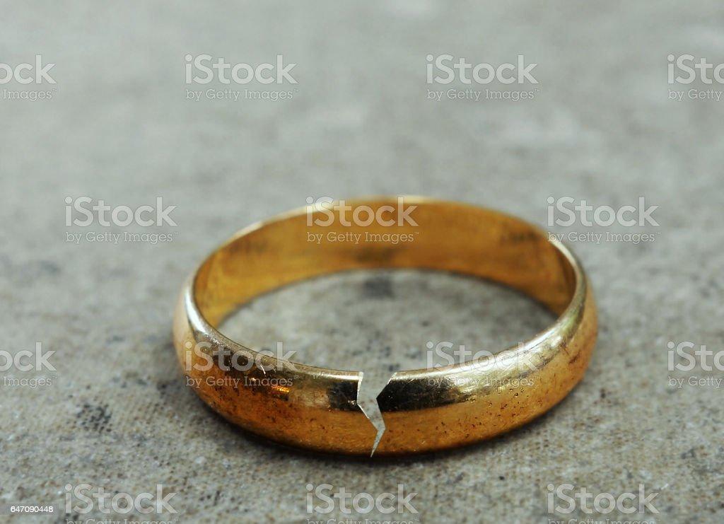 Broken gold wedding band stock photo