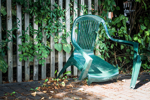 broken green garden chair