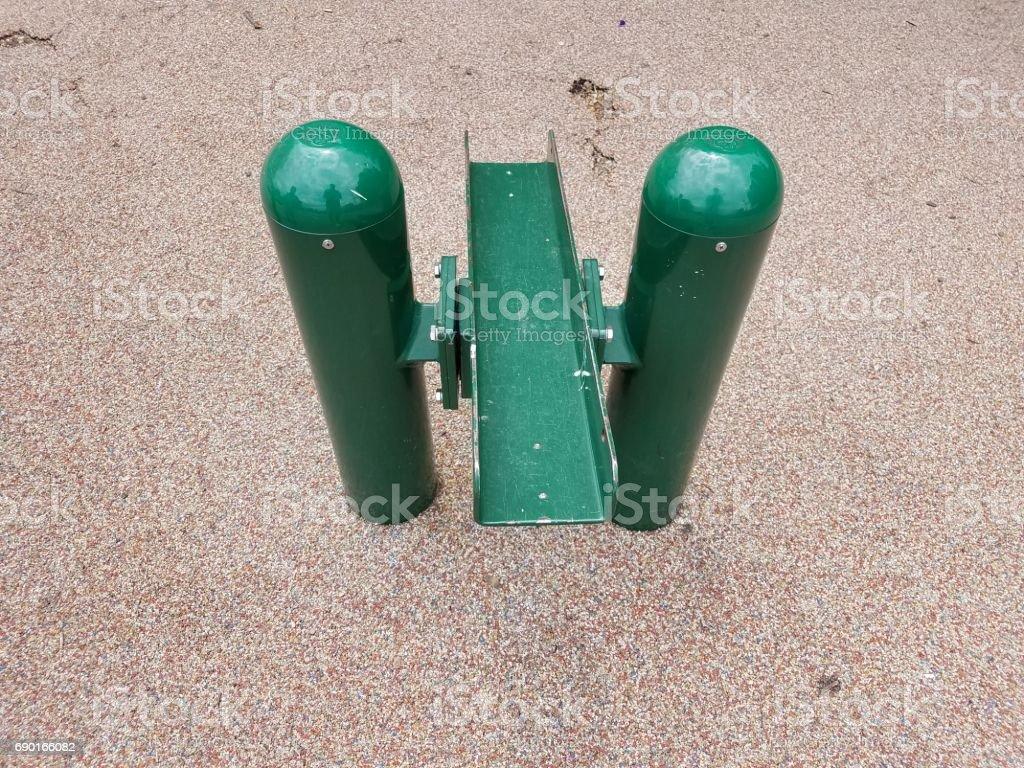 broken green metal seesaw stock photo
