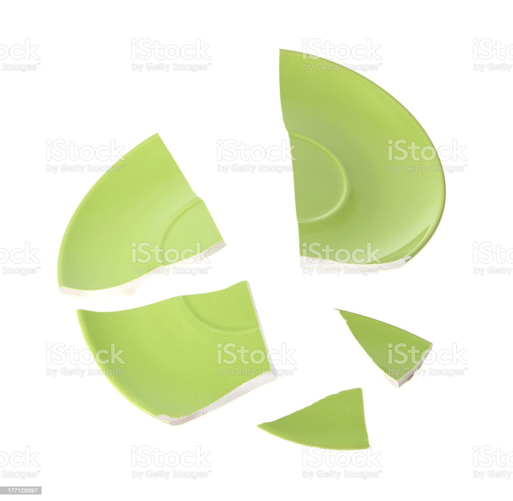 Broken green plate stock photo